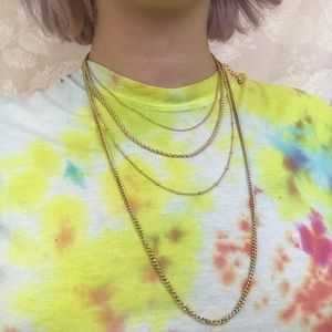 4 gold cabin necklaces